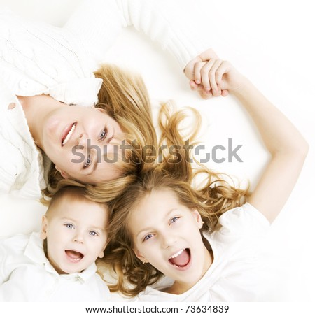 Mother with kids.Happy Smiling Family over white - stock photo