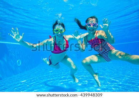 mother with  little daughter  played under water in the pool - stock photo