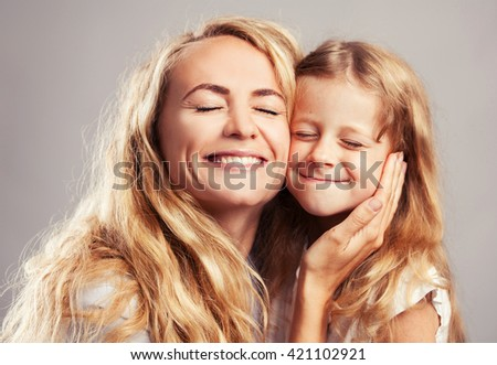 Mother with little girl. Parent with child. Happy family close up