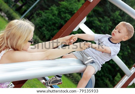 Mother with little son at the playground - stock photo