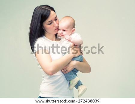 Mother with new baby born portrait studio  - stock photo