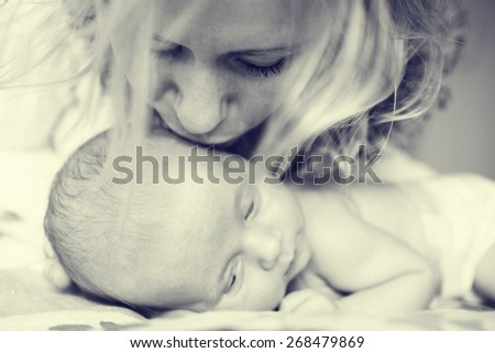 Mother with newborn baby child family home black and white - stock photo