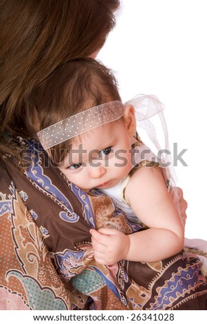 Mother with sad baby on shoulder isolated - stock photo
