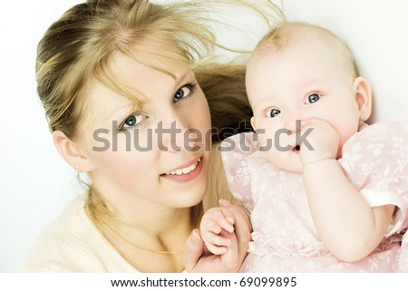 Mother with six month baby looking at you