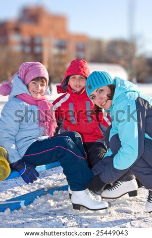 Mother with son and daughter at the skating rink - stock photo