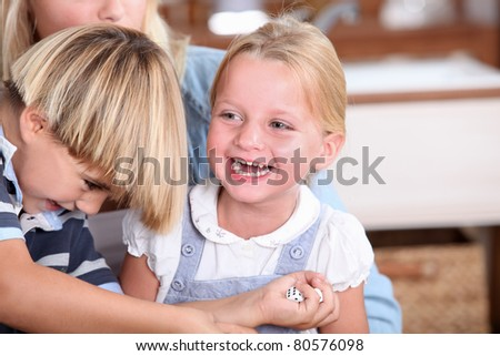 Mother with son and daughter in kitchen - stock photo