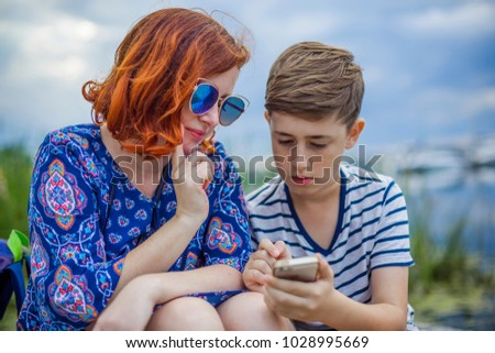 Mother with son and smartphone