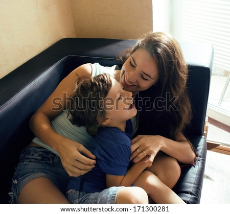 mother with son, happy family at home - stock photo