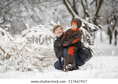 mother with son in winter park