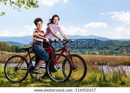 Mother with son riding bikes