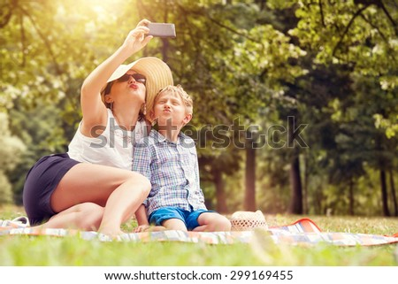 Mother with son take a selfie photo - stock photo