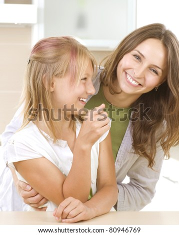 Mother with teenage Daughter having fun. Kitchen.Happy family - stock photo