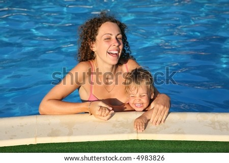 mother with the child in the pond - stock photo