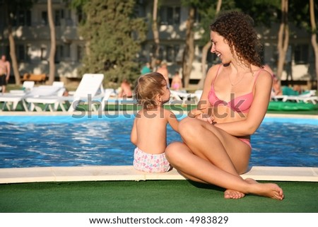 mother with the child near the pond - stock photo