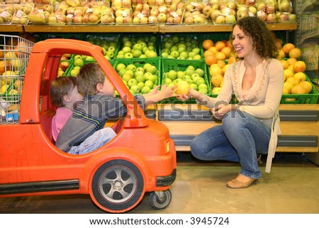 mother with the children in the market - stock photo