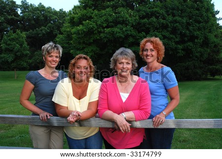 mother with three adult daughters - stock photo