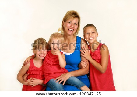mother with three beautiful daughters all blonde and smiling