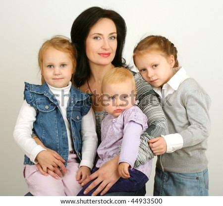 Mother with three daughters on white background
