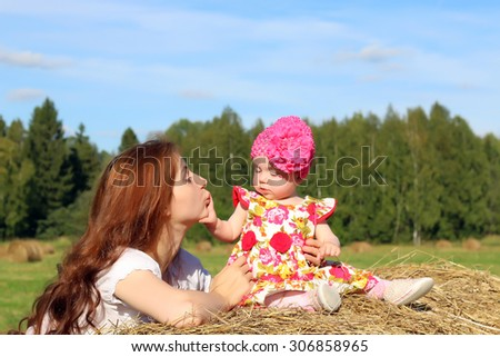 mother with twins in field - stock photo