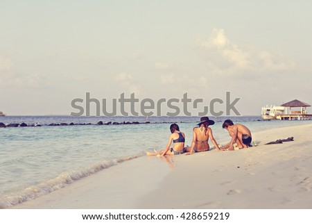 mother with two children girl and boy relaxes on a beach