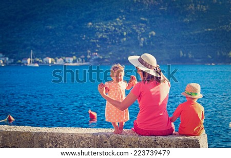 mother with two kids on sea vacation at the sea - stock photo