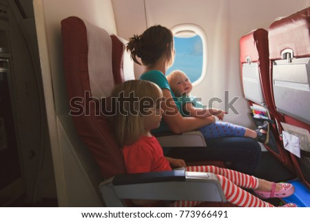 mother with two kids travel by plane