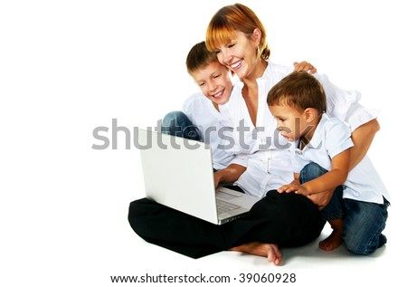 mother with two sons using laptop - stock photo
