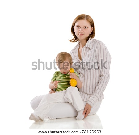 Mother with two years son posing isolated on white