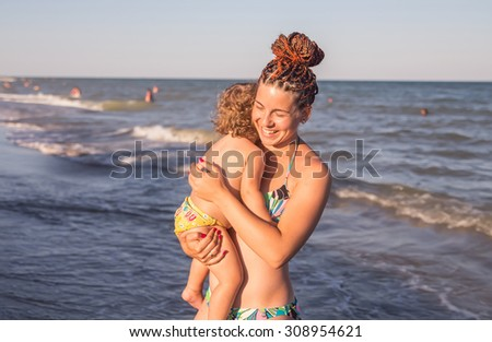 Mother With Young Daughter fun on the Beach  - stock photo