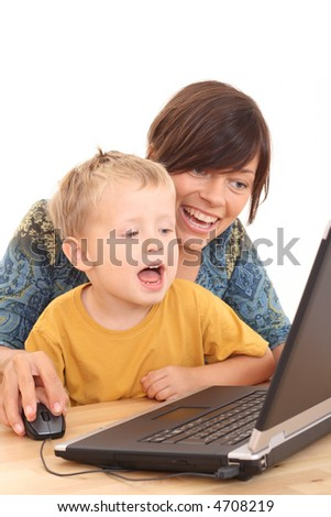 mother 3-4 years old son having fun with computer game isolated on white - stock photo