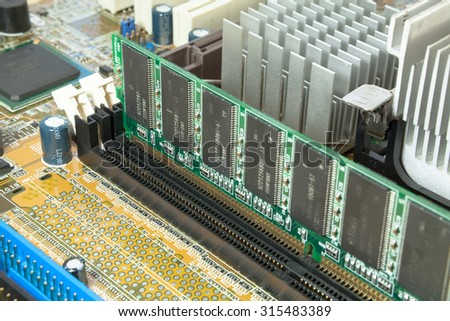 Motherboard and pc components over a wood background for a IOT or comunication and network concepts
