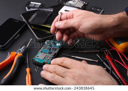 Motherboard and smartphones - stock photo