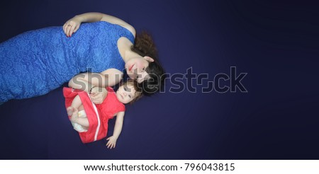 motherhood concept. mom and baby concept of weight after pregnancy. diet with breastfeeding. with a place under your text on a blue background