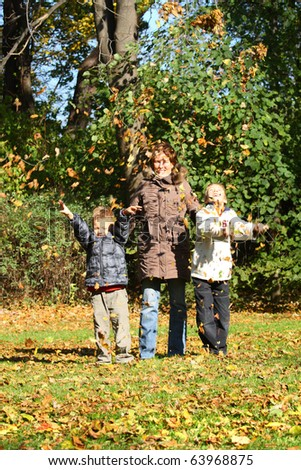 Mothers and children having fun in autumn park. - stock photo