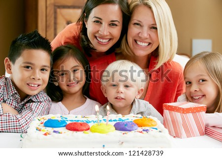 Mothers Celebrating Child's Birthday With Friends - stock photo