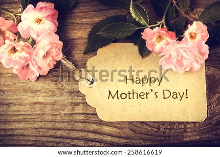 Mothers day card with roses on wood background - stock photo