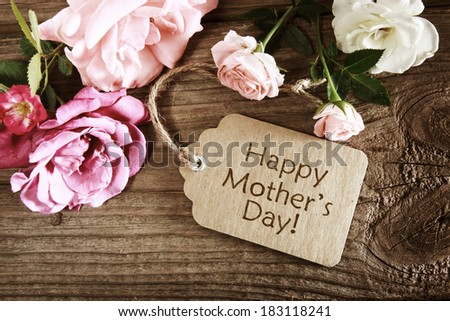 Mothers day card with rustic roses on wooden board - stock photo