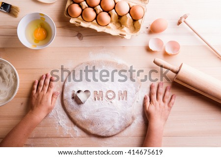 Mothers day composition. Baking cookies. Wooden background - stock photo