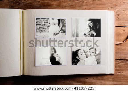Mothers day composition. Photo album, black-and-white pictures. - stock photo