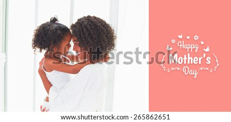 mothers day greeting against cute little girl hugging her mother - stock photo