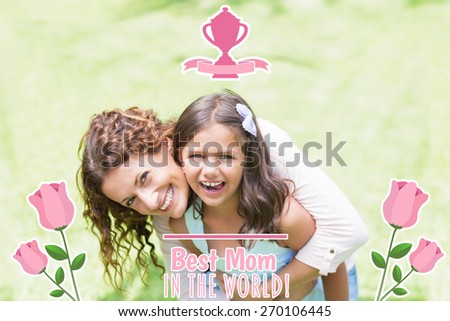 mothers day greeting against happy mother and daughter hugging - stock photo