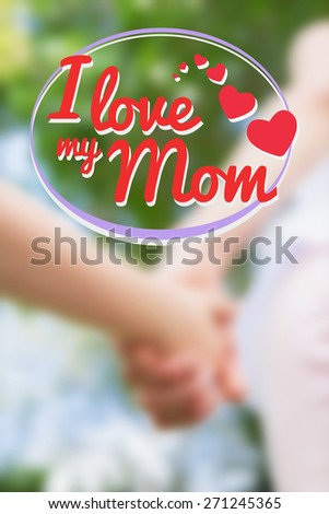 mothers day greeting against mother and daughter holding hands - stock photo