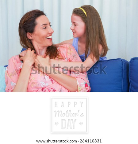 mothers day greeting against mother and daughter smiling at each other - stock photo