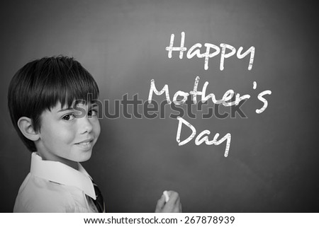 Mothers day greeting against schoolchild with blackboard - stock photo