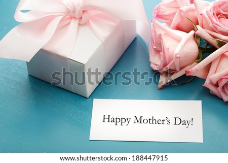 Mothers day message card with gift box and pink roses - stock photo