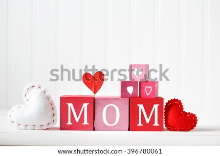 Mothers Day message on red and pink wooden blocks - stock photo
