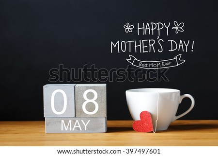 Mothers Day message with coffee cup with wooden blocks - stock photo