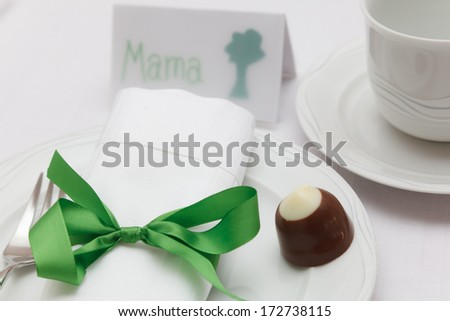Mothers day place setting with name tag - stock photo