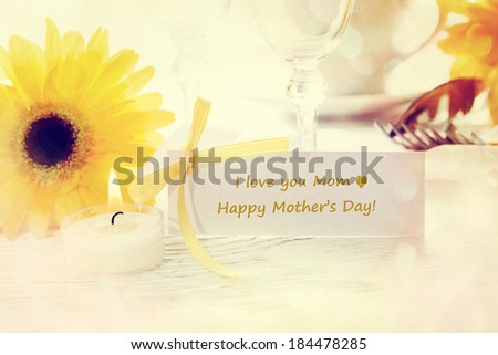Mothers Day table setting with yellow gerberas - stock photo