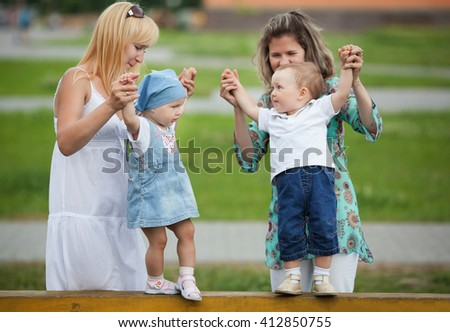 mothers with their children on playground